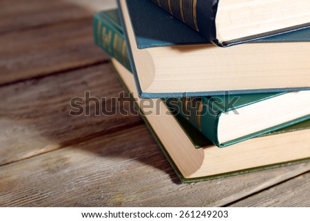 Old books on wooden table, closeup - stock photo