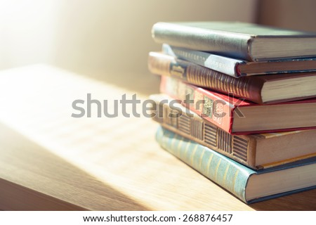 Old books on wooden table.Shallow depth of field. - stock photo