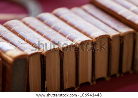 Old books pile from Italian flea market. Horizontal image - stock photo