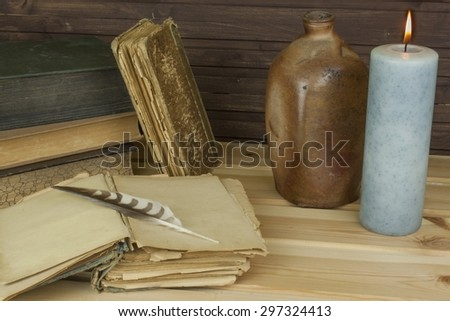 Old books to read. Studying old dictionaries. Historical Library, reading by candlelight. Old books on a wooden table. - stock photo