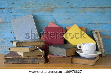 old books with a cup of coffee, free copy space - stock photo
