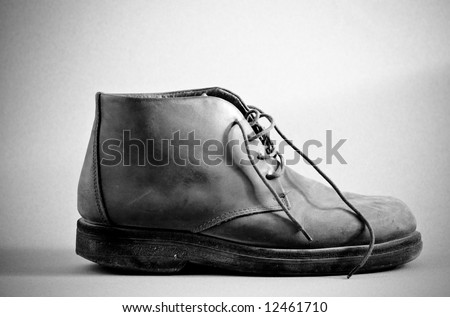 Old Boot series - softer lighting black and white - stock photo