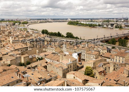 Old Bordeaux cityscape and Garonne river, France - stock photo