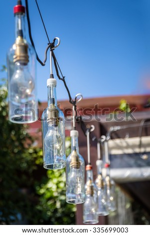 Old bottle lamps on the street - Colonia del Sacramento - Uruguay - stock photo