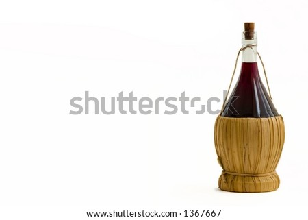 Old bottle of red wine on a white background - stock photo