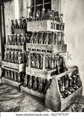 old bottles in wooden boxes - stock photo