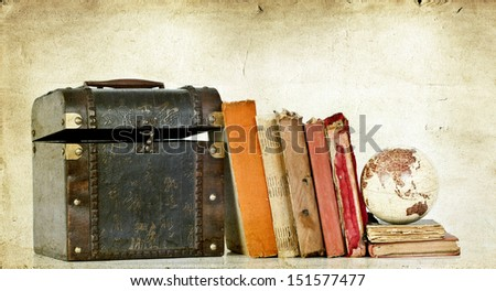 Old box, vintage books and globe earth  - stock photo