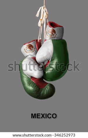 old Boxing Gloves in the Color of Mexico - stock photo