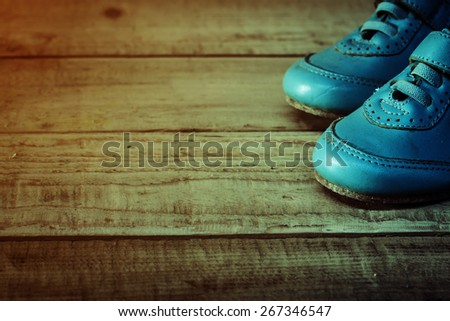 old boy shoes under shadow of window light on wooden floor ,abstract background to first step concept.vintage color photo. - stock photo
