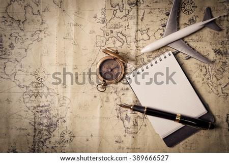 old brass compass on wood table top view - stock photo