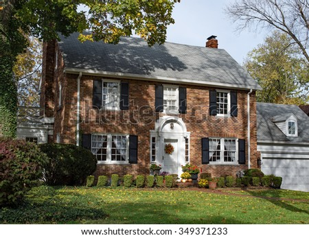 Old Brick Country Home in Autumn - stock photo