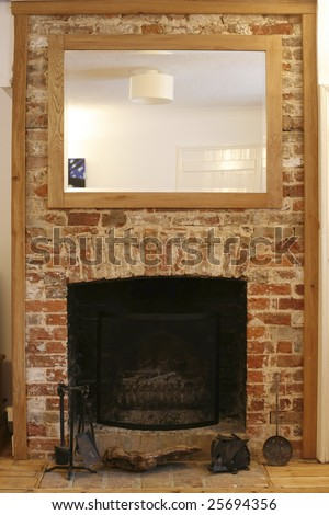 old brick fireplace in renovated house in england - stock photo