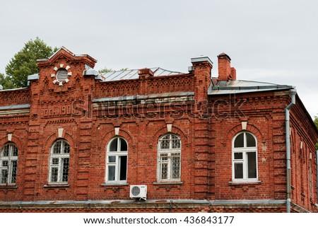 Old brick two-storey house - stock photo