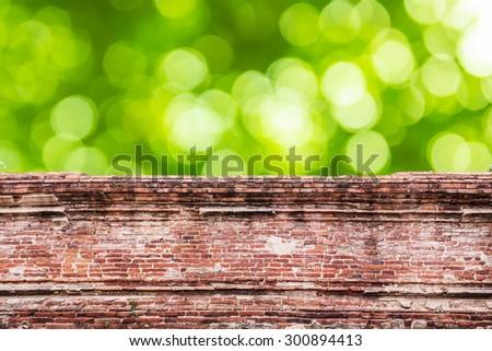 old brick wall and green bokeh beautiful  - stock photo