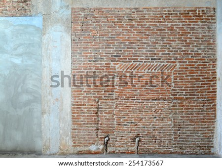 Old brick wall and pipe on concrete texture, background for decorate - stock photo