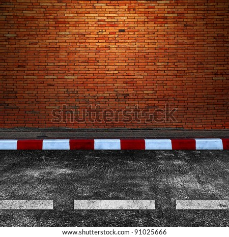 Old Brick Wall and Road Street - stock photo