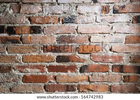 old brick wall background. abandoned house - stock photo