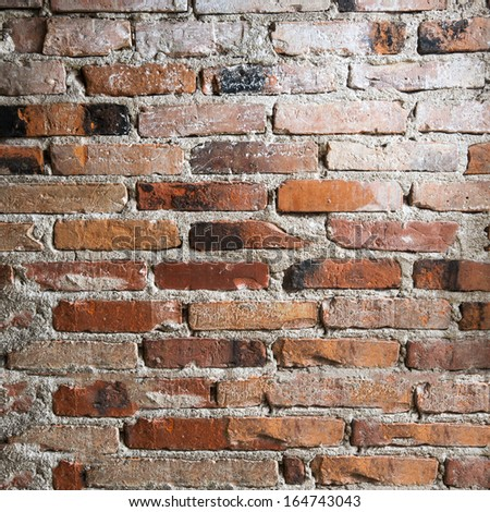 old brick wall background. abandoned house - stock photo