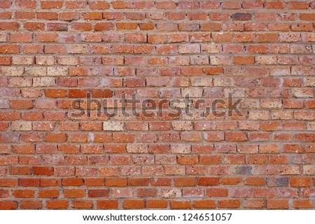Old brick wall background. Macro shot. - stock photo
