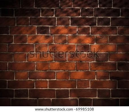 old brick wall background with grid shadow - stock photo