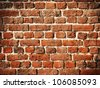 Old brick wall for background with soft vignette - stock photo