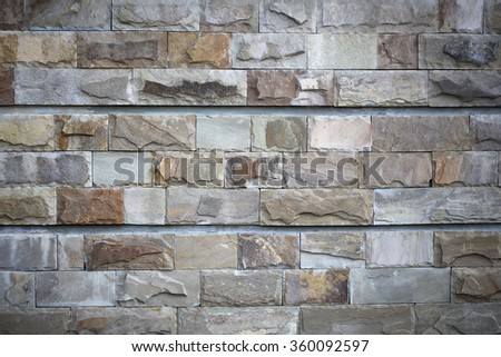 Old brick wall in grunge style with grey brown cement rusty block surface textured wallpaper backdrop brickwall background copyspace closeup, horizontal picture - stock photo