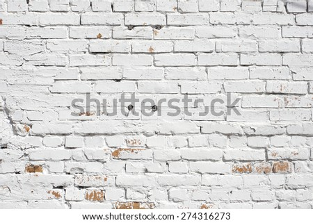 Old brick wall painted with white paint. background texture - stock photo