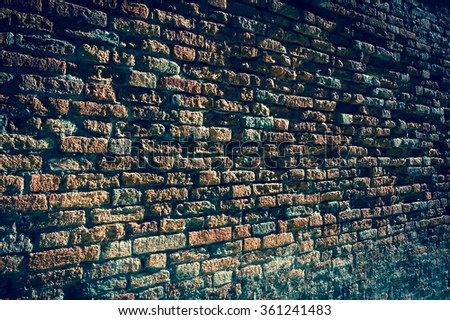 Old brick wall perspective (Venice, Italy). A game of light and shadow. Toned photo. - stock photo