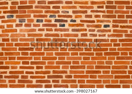 Old brick wall. Texture of wall from a red brick. The background of bricks. Brickwork of an ancient building. - stock photo
