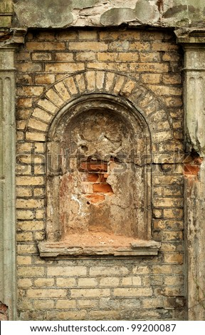 Old brick wall with arc - stock photo