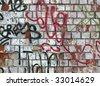 Old brick wall with graffiti - stock photo