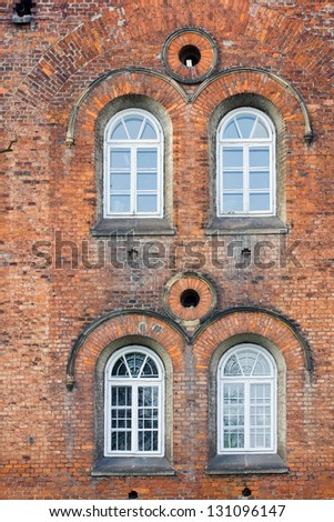 Old Brick Wall with White Windows - stock photo