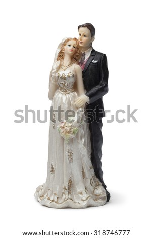 Old bride and groom cake topper on white background - stock photo