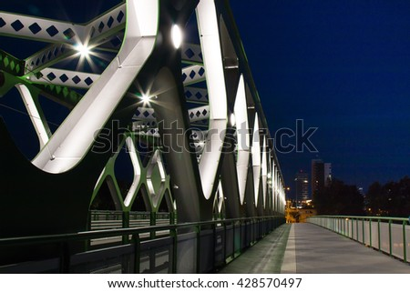 Old bridge in Bratislava, Slovakia On the place of the oldest bridge in Bratislava, Slovakia, new opened Old Bridge for the trams and pedestrians. Details of the bridge in the night light.  - stock photo
