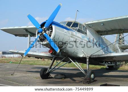 Old broken biplane - stock photo