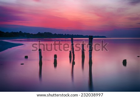 Old broken pier at sunset on the coast of the Baltic sea, Latvia - stock photo