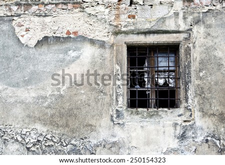 Old broken window part of decaying building - stock photo