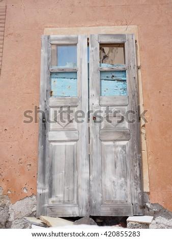 old broken wooden door - stock photo