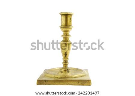 Old bronze candlestick holder isolated on white background - stock photo