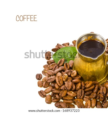Old  bronze coffee maker and roasted coffee beans scattered decorated with green leaves, isolated on white background - stock photo