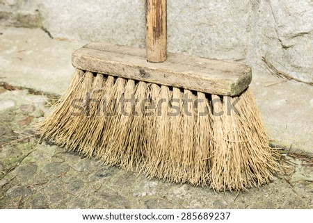 Old broom - stock photo