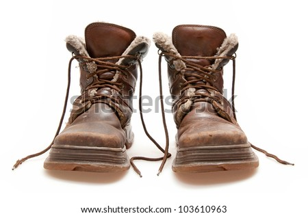 old brown boots isolated on white - stock photo