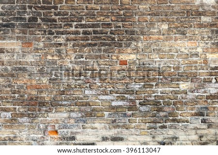 Old brown brick wall, background photo texture - stock photo
