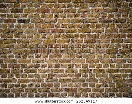 Old brown brick wall for texture or background - stock photo