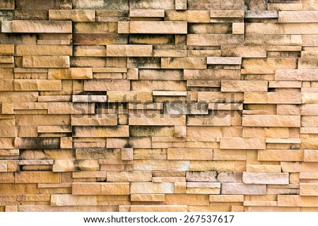 Old brown bricks wall pattern - stock photo