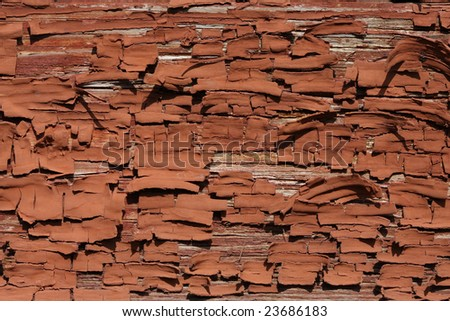 Old brown oil paint, peeling off a wooden wall - stock photo