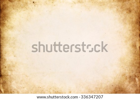 Old brown paper texture with vignette - stock photo