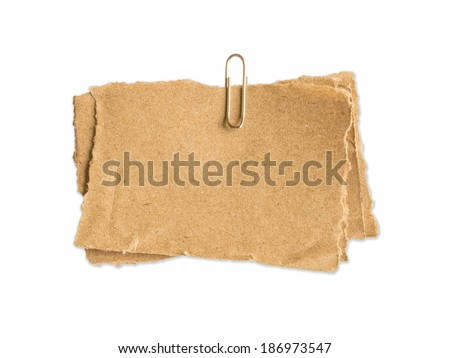 old brown sheet of paper for notes and paper clip - stock photo