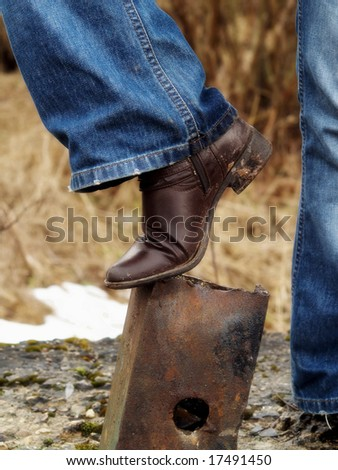 old brown shoe on a rusty metal thing - stock photo