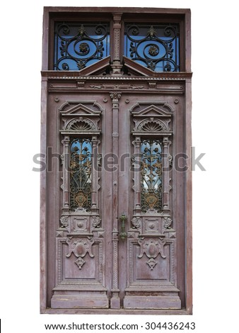 Old brown vintage wooden door with decoration pattern - stock photo